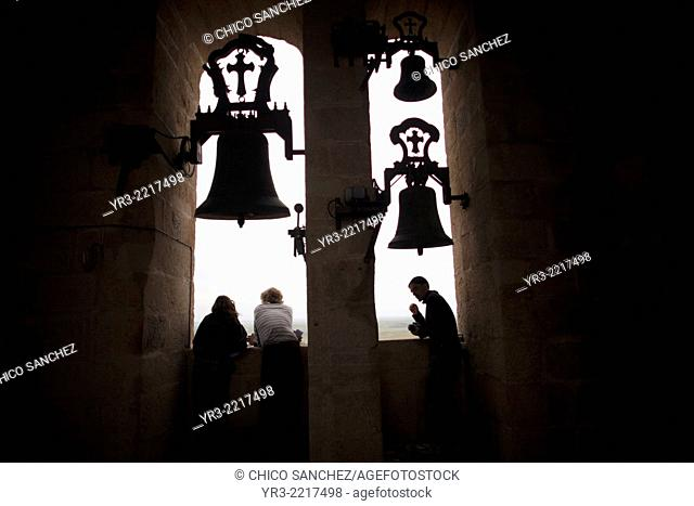 Tourists visit the bell tower of the cathedral of Caceres, Extremadura, Spain