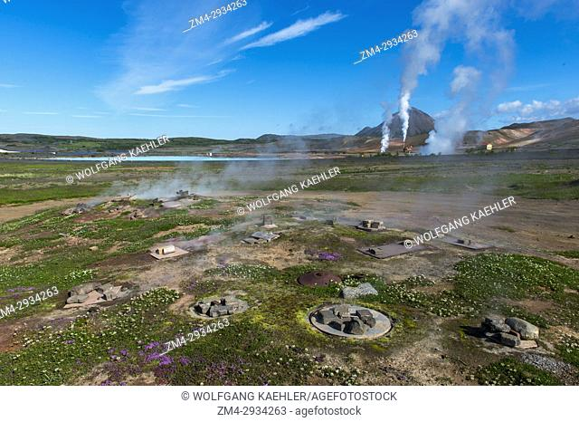 View of the Krafla Geothermic Power Station at Lake Myvatn in Northeast Iceland with underground ovens for rugbrauth (Icelandic Lava Bread) which is baked using...