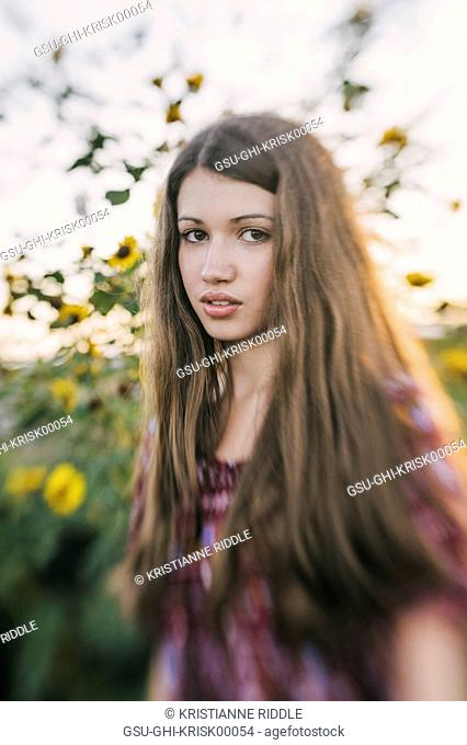 Teen Girl Portrait with Yellow flowers in Background, Selective Focus