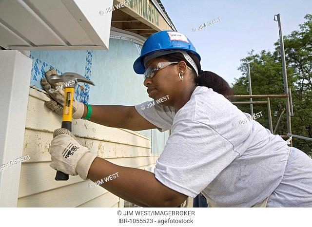 Volunteers helps building 12 homes for low-income families in one week through Habitat for Humanity, Detroit, Michigan, USA