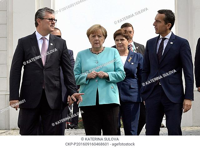 German Chancellor Angela Merkel (2nd left) and Poland's Prime Minister Beata Szydlo (2nd right) arrive for an EU summit at Bratislava Castle in Bratislava