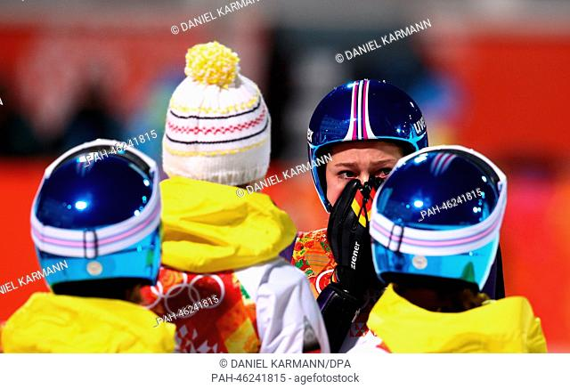 Carina Vogt (2nd R) of Germany celebrates with her teammates after winning the gold medal in the Ladies' Normal Hill Individual competition in RusSki Gorki...