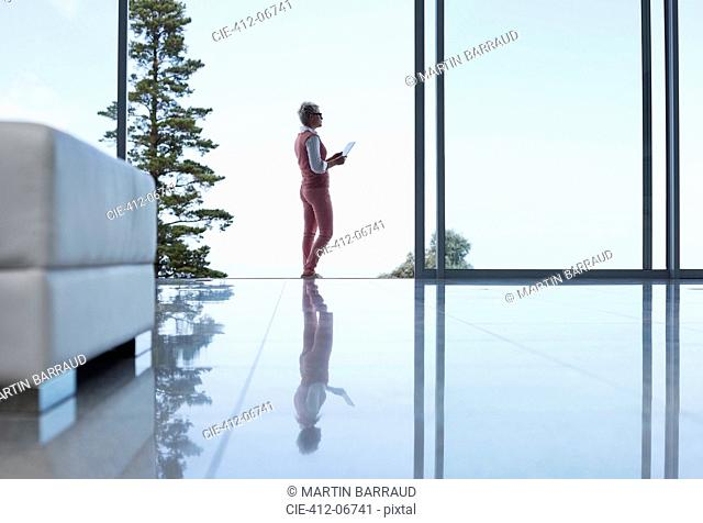 Reflection of businesswoman on office floor