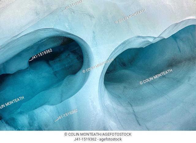 Tunnel in crevasse ice wall, Franz Josef Glacier, Westland National Park, West Coast, South Island, New Zealand