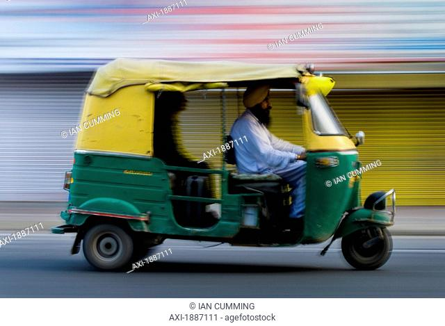 Sikh Driving Rickshaw Early In The Morning, Blurred Motion
