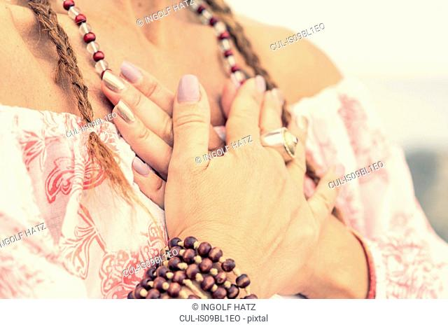 Woman covering chest with hands
