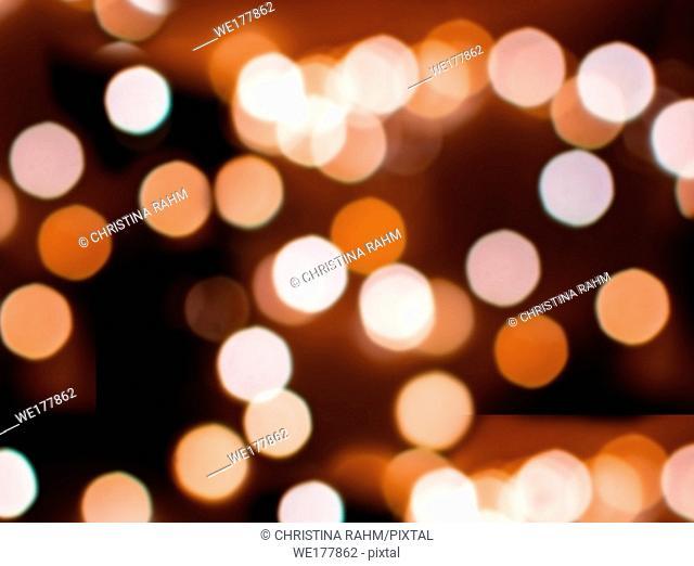 Bokeh lights defocussed burnt orange festive winter background texture