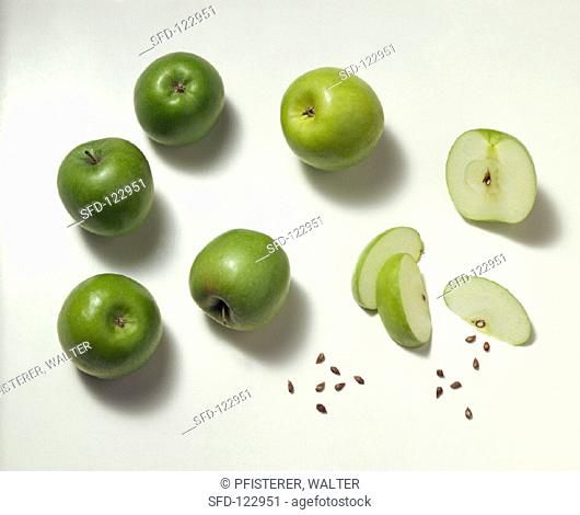 Whole and Sliced Granny Smith Apples