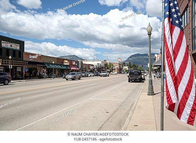 Main street and American flag, Cody, Wyoming, United States, North America, USA