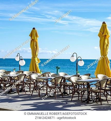 Menton seafront, terrace cafe, Provence Alpes Cote Azur, French Riviera, France