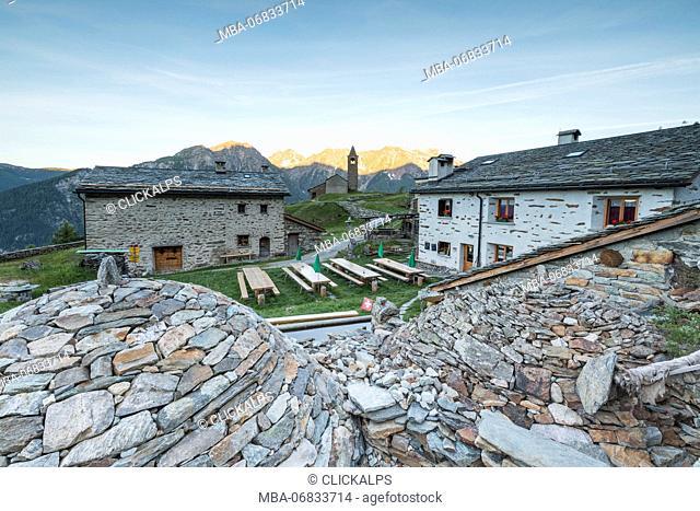 Mountain retreat and old stone caves called Crotto, San Romerio Alp, Brusio, Canton of Graubünden, Poschiavo valley, Switzerland