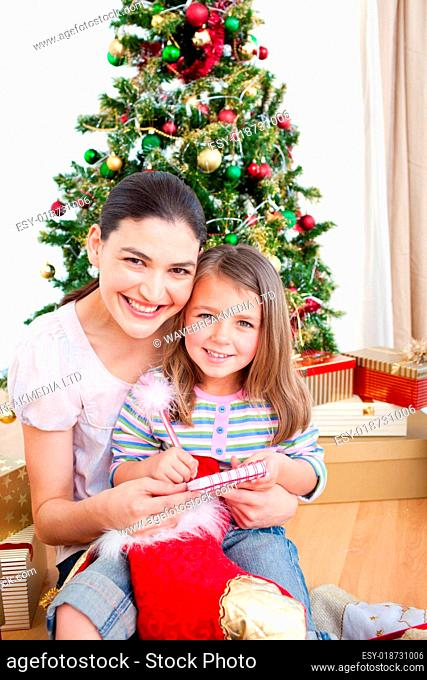 Mother and daughter at home at Christmas