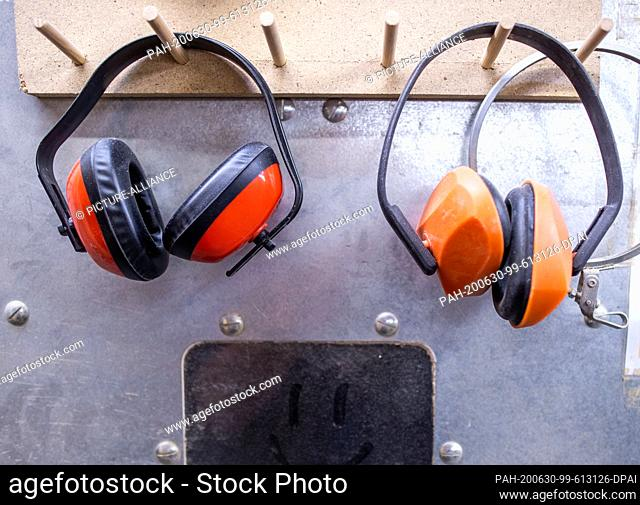 "22 June 2020, Mecklenburg-Western Pomerania, Rostock: Hearing protectors to protect against machine noise are hanging in the workshop """"Historical keyboard..."