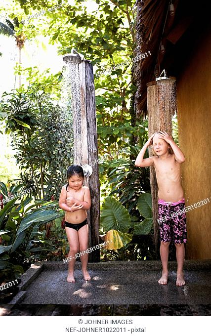Thailand, children taking shower
