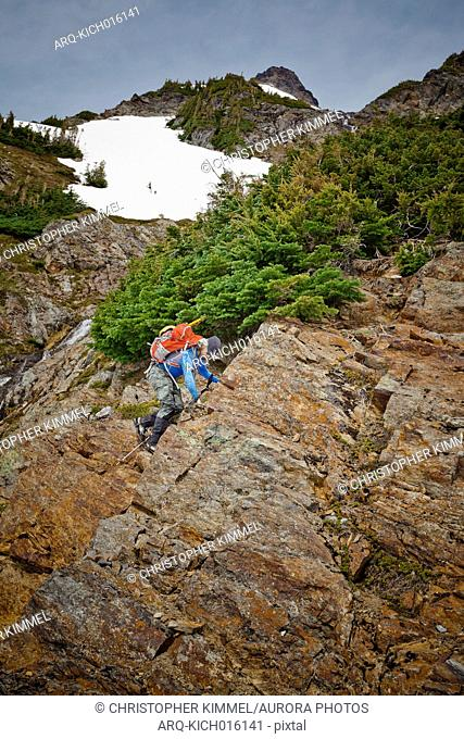Side view of single male mountain climber climbing Foley Peak, North Cascade Mountain Range, Chilliwack, British Columbia, Canada