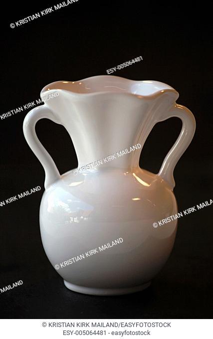 White vase on black background