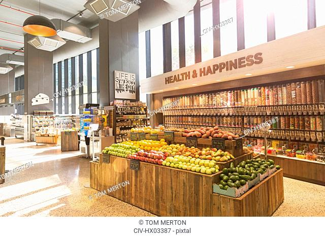 Produce and bulk food on display in health food grocery store market