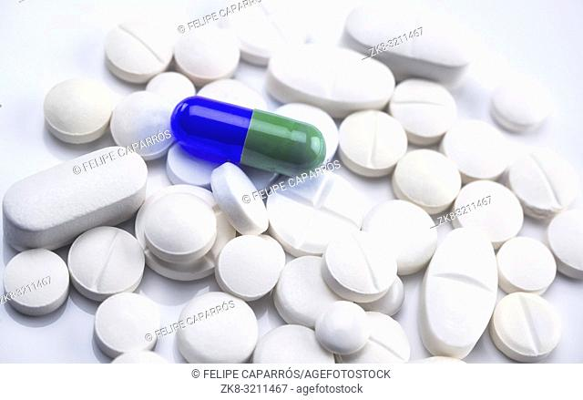 Capsule blue and green on some tablets are white, conceptual image