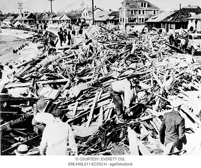 Great Hurricane of 1938. Rescue workers combing debris at Myrtle Beach, Connecticut. 700 people were killed during the September 1938 storm