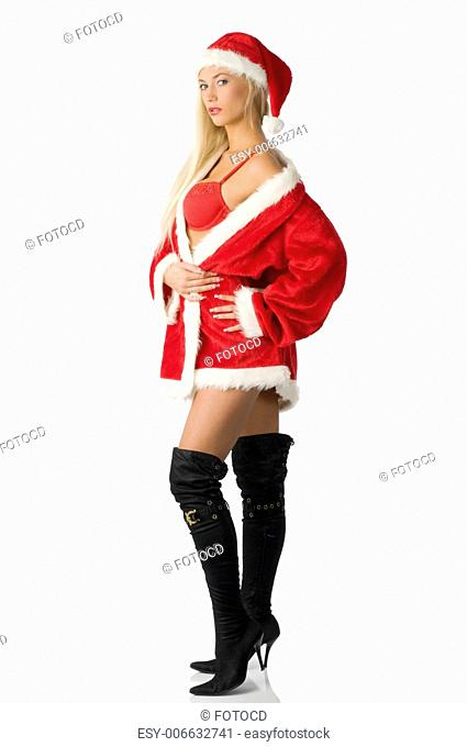 blond girl with santa claus dress and black boots in sensual pose