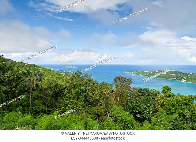 This is a scenic overlook of Magens Bay, St. Thomas, U. S. Virgin Islands. The image contains Ocean, sky and lushly foliaged hills