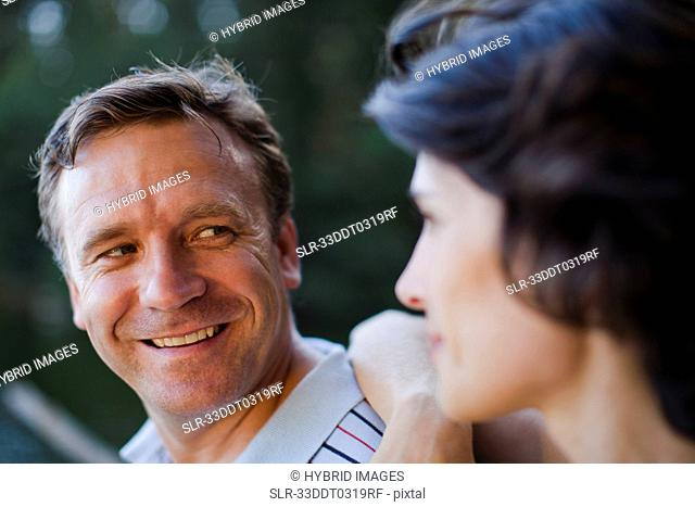 Smiling couple talking outdoors
