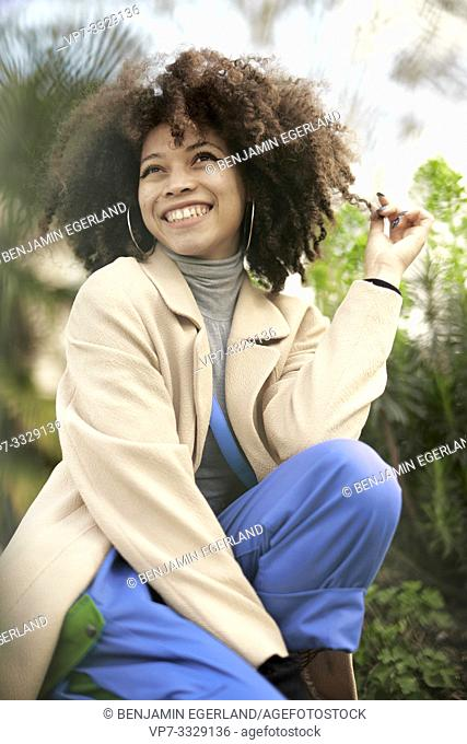 happy young woman, in Paris, France