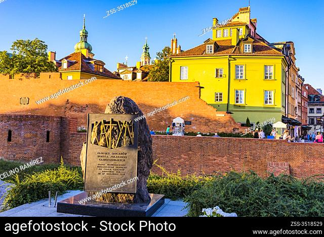 Katyn monument in Warsaw, commemorating the victims of the Katyn massacre designed by the sculptor Andrzej Renes, in the background historical houses in the...