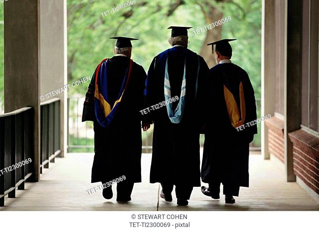 Three adult graduates
