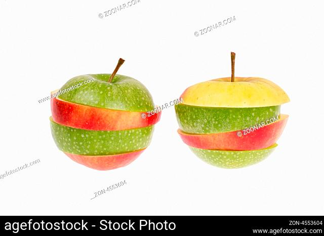 A sliced green and red apple isolated on a white background