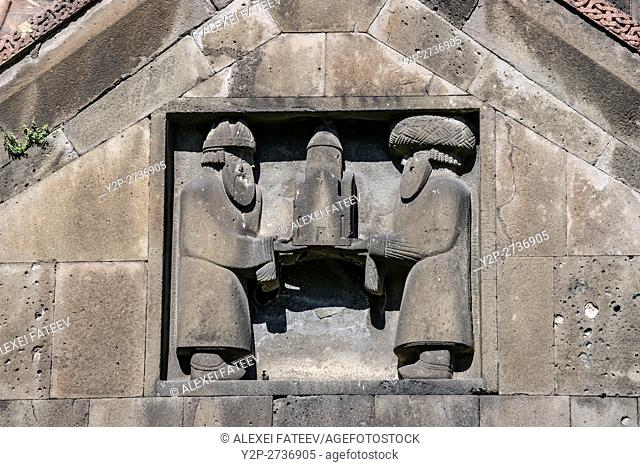 Bas-relief on eastern facade of Surp Nshan church depicting ktetors of the monastery. Haghpat monastery in Armenia