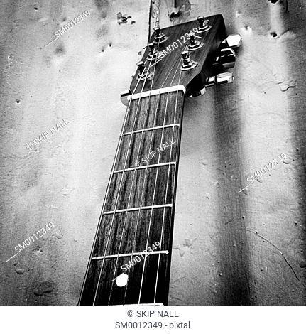 Closeup of the neck of a guitar
