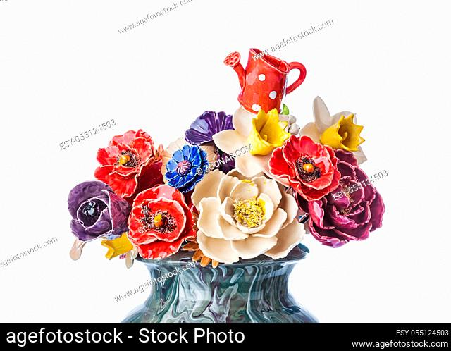 Ceramic decorative flowers bouquet in vase isolated on white background
