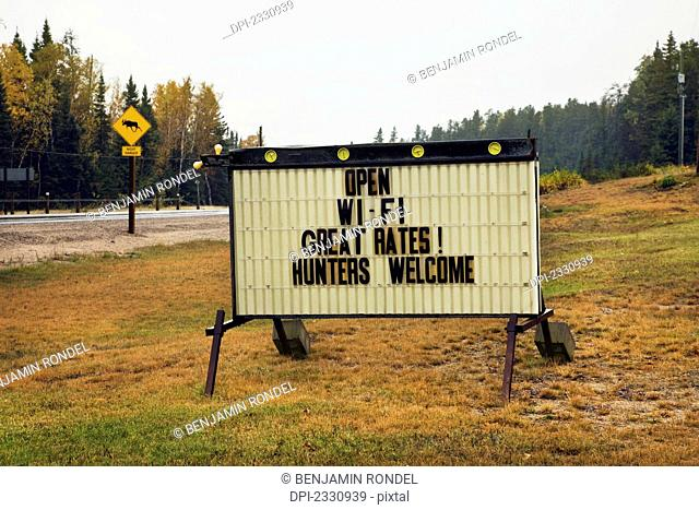 Sign advertising accommodation hunters welcome;Ontario canada