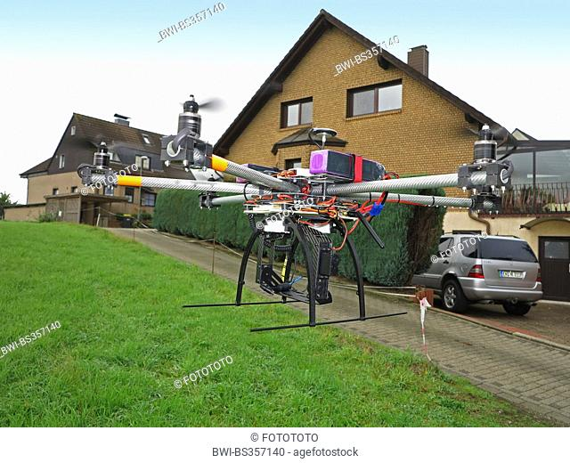 civile drone flying on the edge of a residential area, Germany