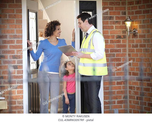 Energy worker talking to family