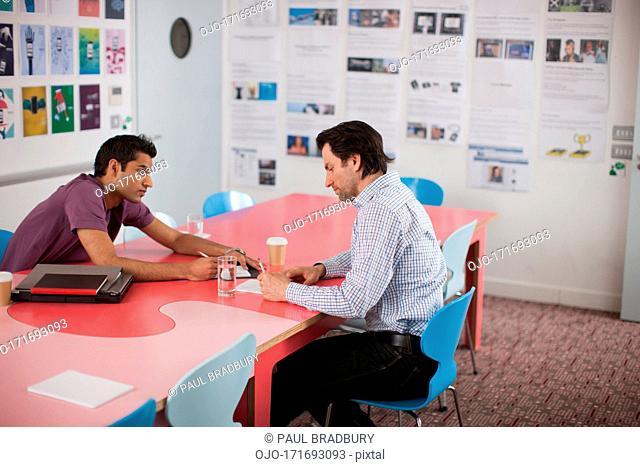 Men talking in meeting