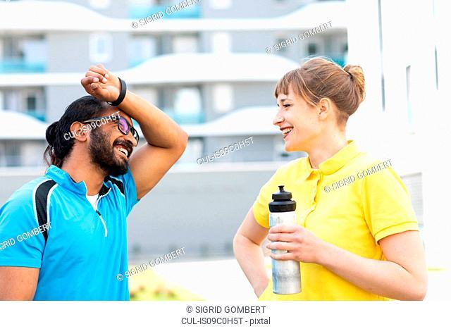 Multi-ethnic couple taking break after exercise