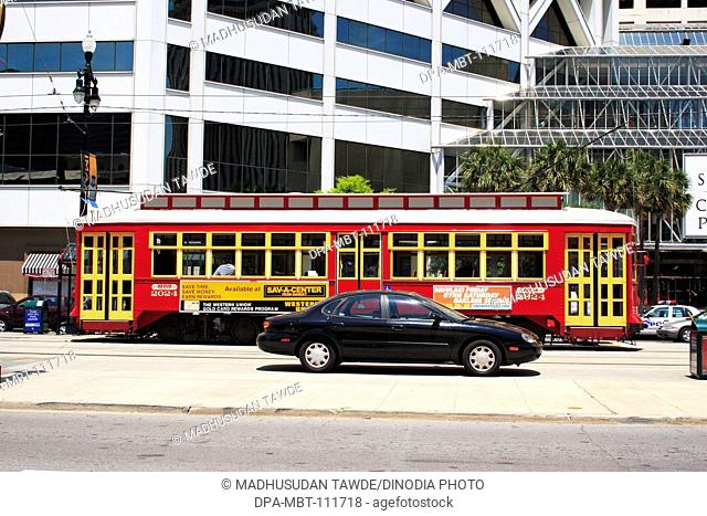A private car and public transportation ; canal street ; New Orleans ; Louisiana ; U.S.A. United States of America