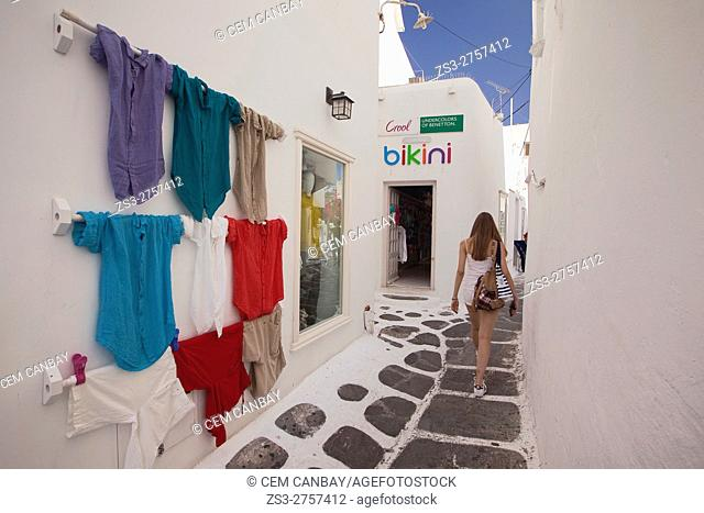 Colorful shirts of a shop for sale in the alleys of the town, Mykonos, Cyclades Islands, Greek Islands, Greece, Europe