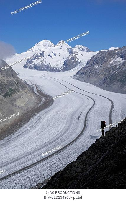 Caucasian hiker on snowy road, Aletsch Glacier, Canton Graubunden, Switzerland