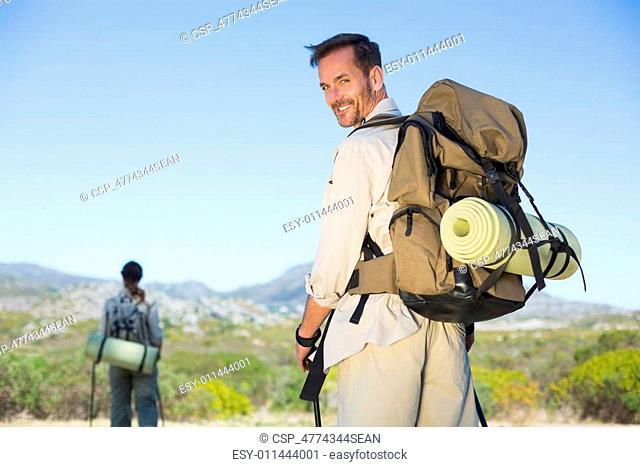 Happy hiking couple walking on moun