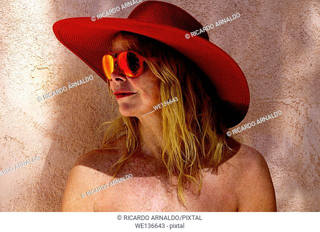 Blond with red beach hat