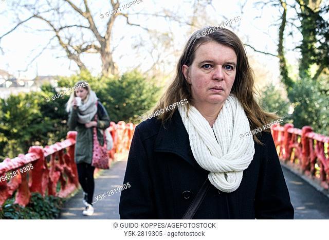 Breda, Netherlands. Portrait mid adult caucasian woman, standing on a city park's bridge