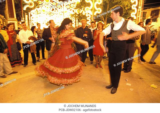 Jerez de la Frontera, a couple is dancing a sevillana on the fairground of the Feria del caballo