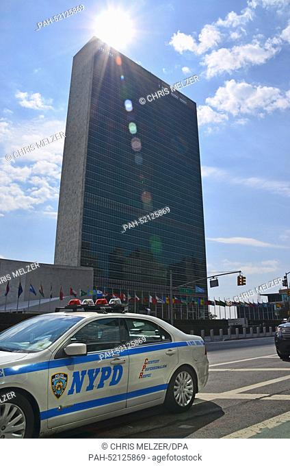 A police car of the NYPD drives past the UN building in New York, United States, 19 September 2014. Starting on 23 September 2014