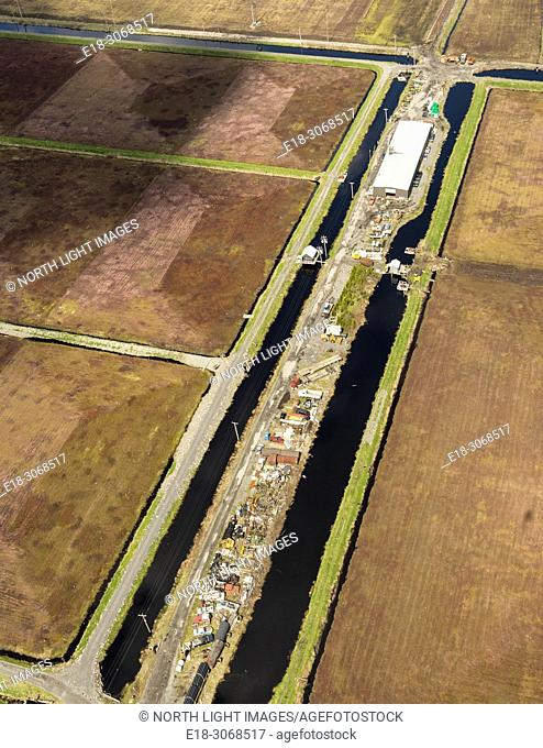 Canada, BC, Delta. Aerial view of cranberry fields separated by irrigation canal