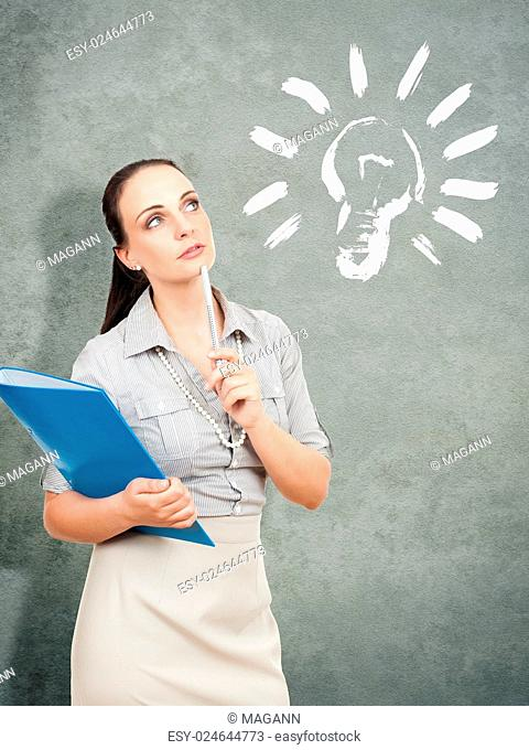 A business woman with a blue folder has an idea