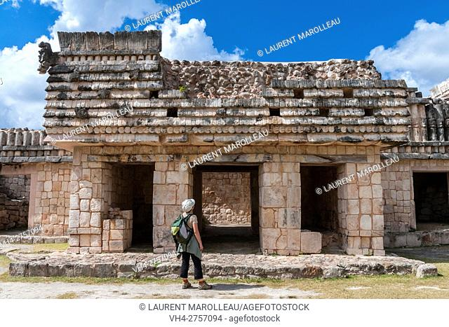 Tourist Watching the House of the Birds in front of Pyramid of the Magician, Uxmal Mayan Archaeological site, State of Yucatan, Mexico, North America