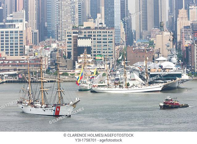US Coast Guard Barque Eagle participates in the Parade of Sail on the Hudson River with other Tall Ships near the Intrepid Sea, Air